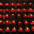 Rows of firing candles in catholic church — ストック写真