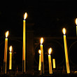 Candles in catholic church on dark background — Stock Photo