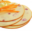 Foto Stock: Closeup image of pieces of cheese with ham and carrots isolated on white