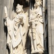 Two medieval gothic statues decorating entry to cathedral in Koeln, Germany in a bright day — Stock Photo