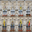 Medieval gothic architecture of Grand Place in Leuven, Belgium with flags of Belgian provinces — Stock Photo