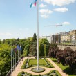 Park in historical center of Luxembourg city and flag — Stock Photo