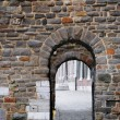Narrow medieval gate in historical center of Maastricht — Stockfoto