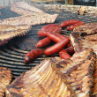 Stok fotoğraf: Outdoor preparation of different kinds of meat and sausages