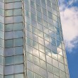 Sky reflections in windows of modern sky-scraper — Stock Photo