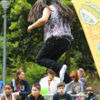 Unidentified minor jumping on trampoline during National Day of Belgium — Stock Photo
