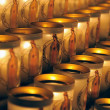 Especially designed candles with image of Mary lit by visitors of Notre Dame de Paris on March 22, 2009 in Paris. — Photo