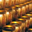 Stock Photo: Especially designed candles with image of Mary lit by visitors of Notre Dame de Paris on March 22, 2009 in Paris.