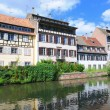 "View from river of tourist area ""Petite France"" in Strasbourg, France with reflections in water — Stock Photo"