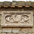 Wall from roman times decorated with relief in Rome, Italy, Forum area - Stock Photo