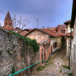 Street in Avigliana village known from 13 century in rainy spring day — Stock Photo