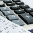 Stock Photo: Printed receipt from shop on calculator closeup image