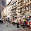 Stock Photo: Tourists bring significant part of income for local in Alsace and come for shopping in historical center of Strasbourg from m