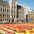 Stock Photo: Thousands of tourists from entire world come to see africtheme Flower Carpet on Grand Place