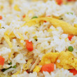 Foto Stock: Hot thai rice with fried eggs and vegetables