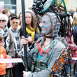 Stock Photo: Unidentified participant plays electronic personage during Zinneke Parade on May 19, 2012 in Brussels