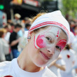 Stock Photo: Unidentified participant shows pink and white personage during Zinneke Parade on May 19, 2012 in Brussels