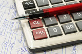 Ball pen, calculator and text written especially for this photo — Stock Photo
