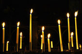 Candles in catholic church on dark background — Foto Stock