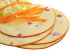 Closeup image of pieces of cheese with ham and carrots isolated on white — Stock Photo
