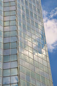 Sky reflections in windows of modern sky-scraper — Stock Photo