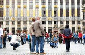 One of mostly visited tourist places - Grand Place was especially crowded during National Day of Belgium — Stock Photo