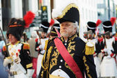 Unidentified performer shows military uniform of 19 century during defile on National Day of Belgium — Stock Photo