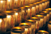 Especially designed candles with image of Mary lit by visitors of Notre Dame de Paris on March 22, 2009 in Paris. — Stock Photo