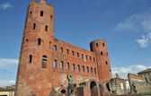 Ruins of roman Porta Palatina on blue sky in center of Turin, Italy — Stock Photo
