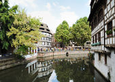 Crowded by thousands of tourists Petit France area of Strasbourg in best time of season on August 21, 2010 — Stock Photo