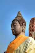Medieval Statue of Buddha in Ayutthaya in Thailand in yellow dress — Stock Photo