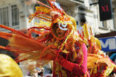 Unknown participant shows costume of mystic creature during Zinneke Parade on May 19, 2012 in Brussels — Stock Photo