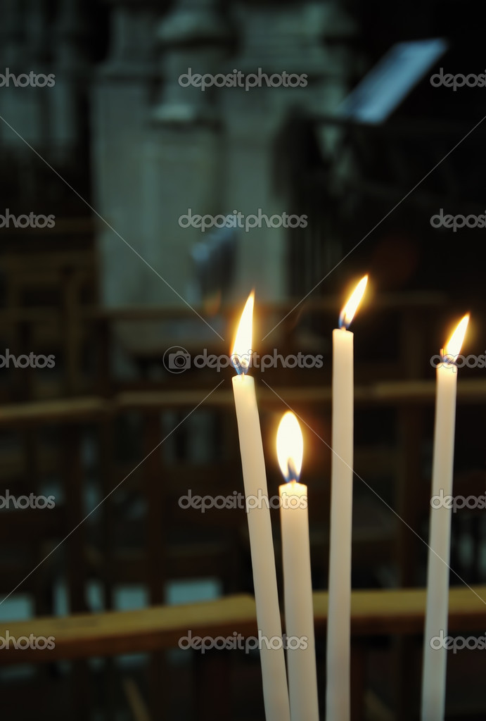 Four white candles in catholic church — Zdjęcie stockowe #12284589