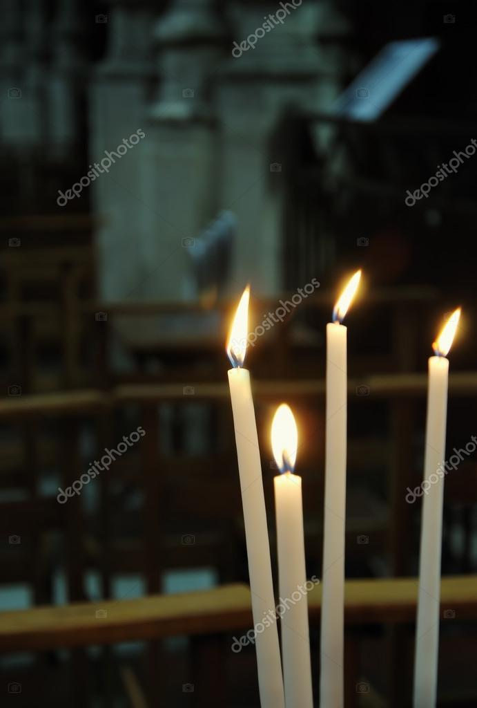 Four white candles in catholic church — Stock fotografie #12284589
