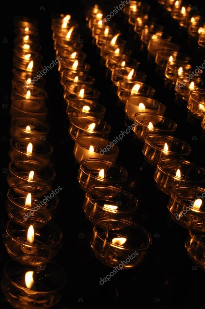 Candles in catholic church on dark background — Stock Photo #12285467