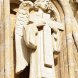 Beautiful Angel with a cross from facade of Petit Sablon church in Brussels, Belgium - Stock Photo