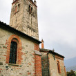 Church in Avigliana village known from 13 century in rainy spring day - Stock Photo