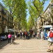 BARCELONA, SPAIN-APRIL, 13: Tourists crowded La Rambla on April 13, 2009 in Barcelona. - Stock Photo