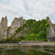 Bayard Rocks in Dinant on the right bank of the river Meuse, Belgium - Stock Photo