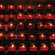 Rows of firing candles in catholic church - Stok fotoğraf