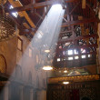 Interior of Coptic church in Cairo with contrast light beams - Stock Photo