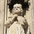 Gothic statue on facade of cathedral in Koeln in sunny day - Stock Photo