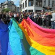 BRUSSELS, BELGIUM-MAY 14: Activists of Gay Pride Parade prepare giant rainbow flag for defile on May 14, 2011 in Brussels. This parade is annual event in Brussels - Stock Photo