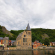 View of old church in Dinant form the river Meuse, Belgium - Stok fotoğraf