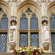 Medieval gothic statues of a king and a queen from facade on Grand Place in Brussels, Belgium - Stock Photo