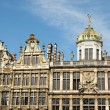 Medieval facades of Grand Place in Brussels in sunny day - Stock Photo