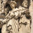 Realistic gothic statues of personages from Bible on exterior walls of Cathedral of St. Michael and St. Gudula in Brussels - Stok fotoğraf