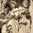 Realistic gothic statues of personages from Bible on exterior walls of Cathedral of St. Michael and St. Gudula in Brussels - Stock Photo