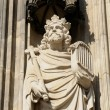 Gothic statue from external wall of Cologne cathedral in sunny day - Stok fotoğraf