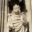 Gothic statue from external wall of Cologne cathedral in sunny day - Stock Photo